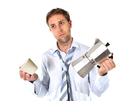 tired and messy business man with hangover holding coffee pot isolated on white background Stock Photo - 25143907