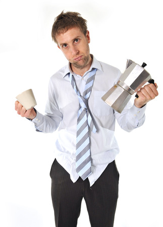 tired and messy business man with hangover holding coffee pot isolated on white background Stock Photo - 25143909