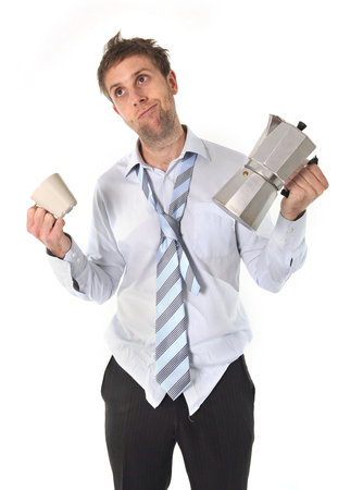 tired and messy business man with hangover holding coffee pot isolated on white background Stock Photo - 25143910