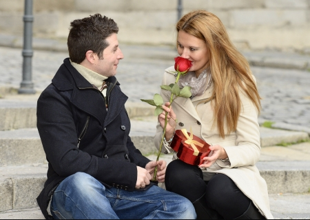 Romantic couple smelling a rose on Valentines day photo