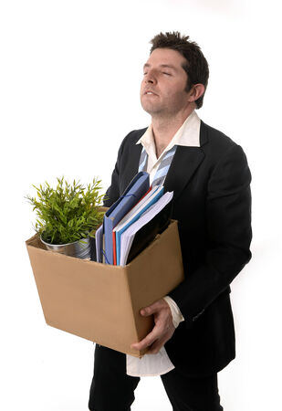 Jobless young Business Man with Cardboard Box Fired from Job isolated on White looking depressed, sad an in stress photo