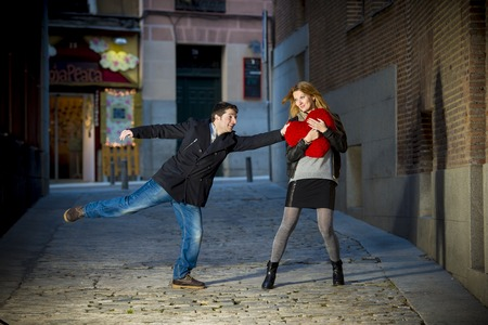 man trying to win the heart of his new girlfriend in a moody street