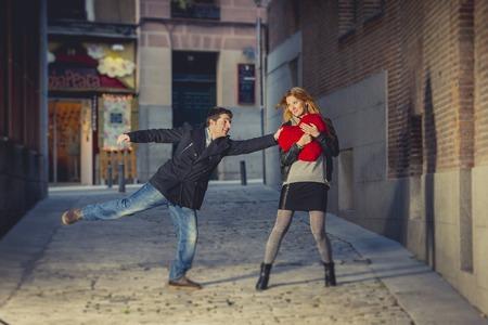man trying to win the heart of his new girlfriend in a moody street  photo