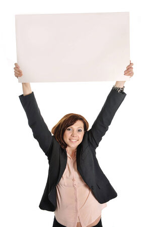 happy successful red hair business woman wearing a suit holding up blank cardboard sign as copy space on white  photo