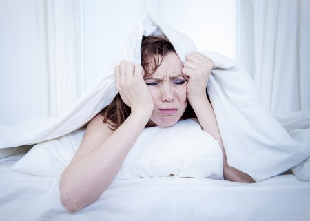 cant: woman with red hair in her bed with insomnia and cant sleep on a white  Stock Photo