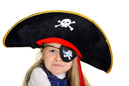 Cute little 5 years old blonde girl playing  in pirate hat and eyepatch isolated on white background photo