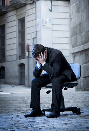 frustrated Business Man sitting on Office Chair on Street in stress and crying