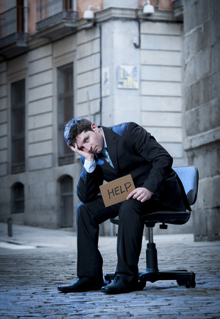 frustrated Business Man sitting on Office Chair on Street in stress photo
