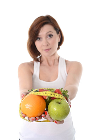 taylor: woman hands with fruit  bond with measure tape slave to diet isolated on white Stock Photo