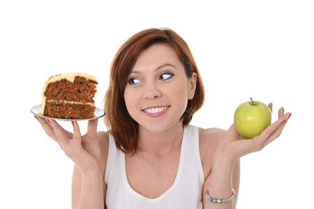 Young Attractive Woman Dessert Choice Junk Cake Food or healthy Apple