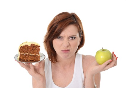 hesitating: Young Attractive Woman Dessert Choice Junk Cake Food or healthy Apple
