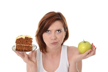 junk: Young Attractive Woman Dessert Choice Junk Cake Food or healthy Apple