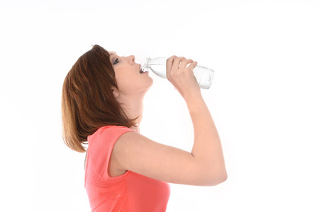 young attractive sport woman drinking water in bottle photo