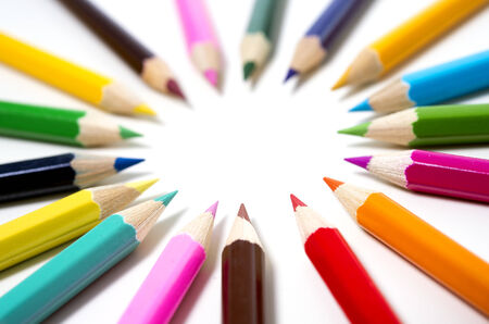 Set of drawing multi colour pencils with copy space isolated on white background photo