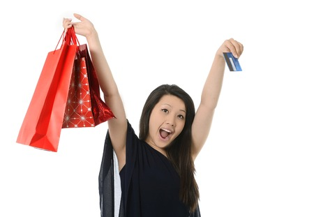 happy asian american with shopping bags and credit card photo
