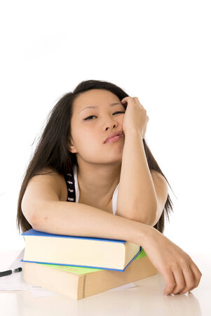 young pretty chinese asian student woman bored tired over worked on her laptop wearing a black shirt on a white background photo