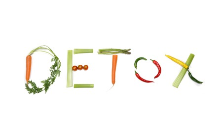 toxins: detox written with vegetables in healthy nutrition and cleaning body toxins concept Stock Photo