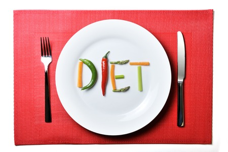 diet written with vegetables in healthy nutrition and dieting resolution concept photo