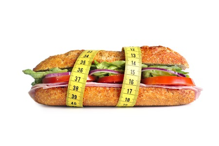 Vegetal Sandwich wrapped in measure tape in diet concept isolated on white background photo