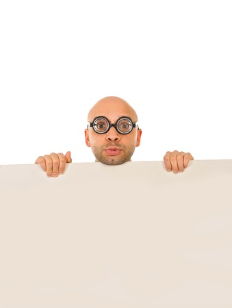 strange looking nerd business man wearing geek glasses holding a white blank sign for copy space or an advertisement on a white background photo