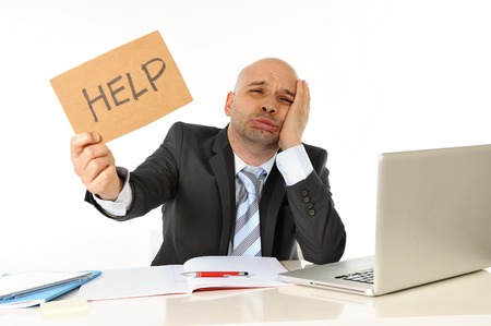 young bald attractive business man in stress overworked with computer asking for help at work Stock Photo