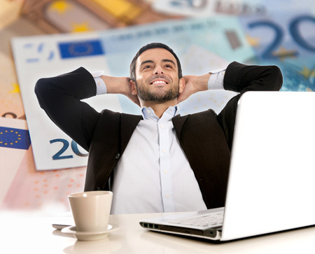 Attractive Happy Young Business Man with beard Thinking and Dreaming of Big Money over Euro Currency Background photo