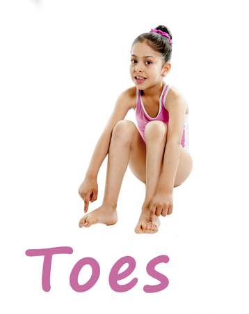 girl wearing a pink swimsuit pointing at her feet on a white background for a school anatomy or body part chart photo