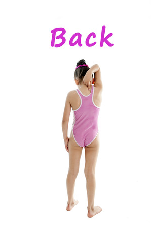 girl wearing a pink swimsuit pointing at her back and shoulder on a white background for a school anatomy or body part chart photo