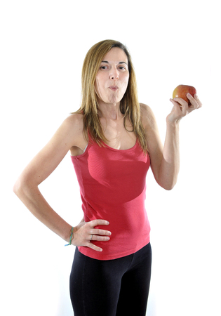happy attractive mature woman on her 40s eating apple fruit in health concept Stock Photo