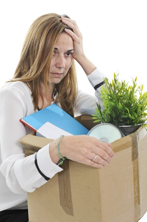 Sad Business Woman with  Cardboard Box  Fired from Job for Financial Crisis photo
