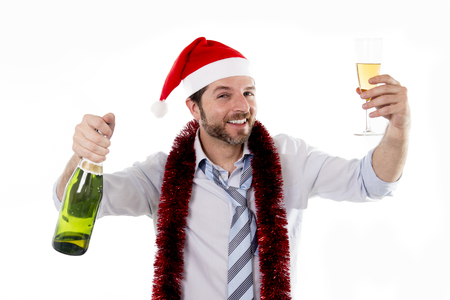 Happy businessman wearing a santa hat with tinsel around his neck in a blue business shirt
