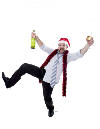 Happy drunk businessman wearing a santa hat