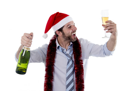 Happy businessman wearing a santa hat  Stock Photo
