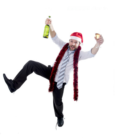 Happy drunk businessman wearing a santa hat with tinsel around his neck in a blue business shirt