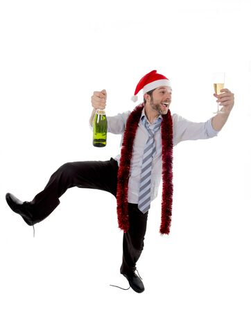 champers: Happy businessman wearing a santa hat with tinsel around his neck in a blue business shirt  Stock Photo