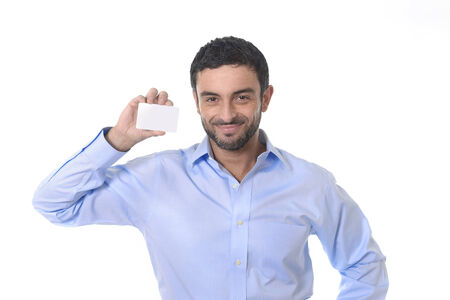 happy young attractive businessman holding blank business card for adding corporate text company name or logo using empty card as copy space isolated on white blackground photo