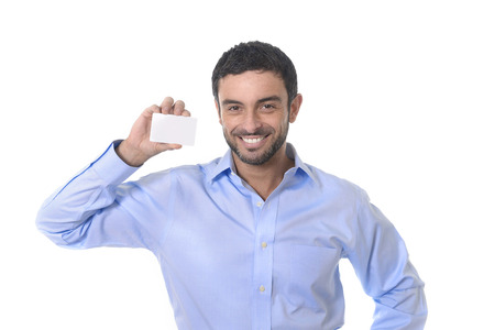 happy young attractive businessman holding blank business card for adding corporate text photo