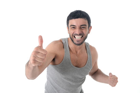 sportman: happy attractive sport man wearing training top singlet giving thumb up for corporate fitness center branding and gym health club marketing images isolated on white background