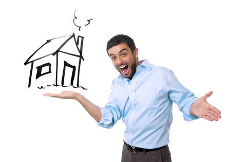 young happy attractive sales man showing house sketch at copy space in housing owner , mortgage banking and new property buying concept isolated on white background photo