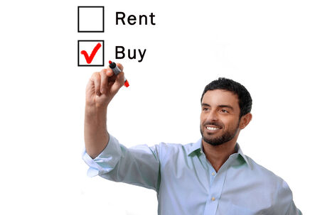 young handsome business man choosing rent or buy option at formular ticking buying box with red marker on glass isolated on white background in housing, real estate and property owner concept photo