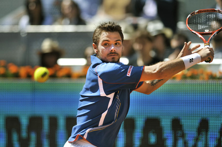 atp: Swiss tennis player Stanislas Wawrinka returns a ball during Mutua Madrid Open 2013 clay court ATP World Tour Masters 1000 tournament in Madrid, Spain at La Caja Magica Venue on May 12,2013 Editorial