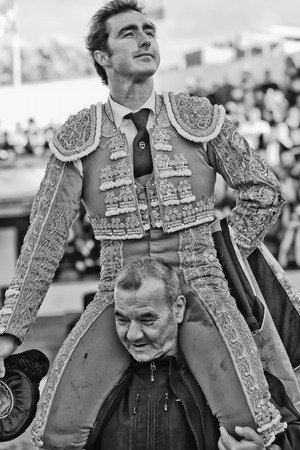 david fandila: MADRID, SPAIN - 10th May 2010. Bullfighting Fiesta. The spanish matador DAVID FANDILA FANDI awarded with turn around the arena up on his mates shoulders at the Valdemoro Bullfight Venue Editorial