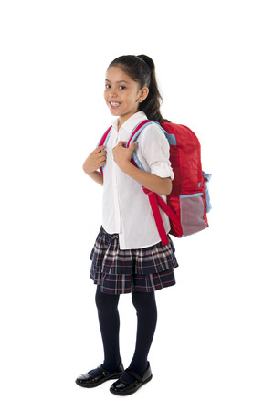 happy sweet little school girl carrying schoolbag backpack and books smiling in education and back to school concept isolated on white background photo