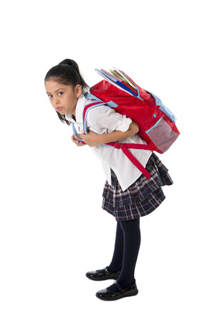 heavy weight: sweet little girl carrying heavy backpack or school bag full  causing stress and pain on back due to overweight isolated on white background
