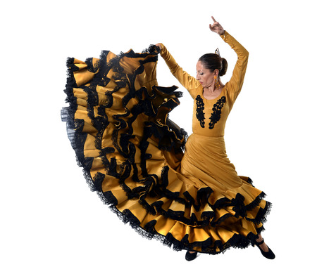 young spanish woman dancing Sevillanas wearing typical folk gold and black  tailed gown dress in flamenco traditional dance of Spain concept isolated on white background photo