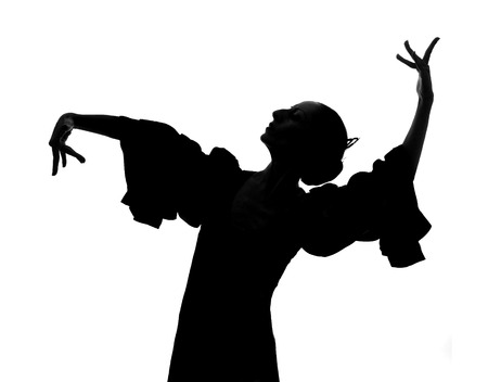 Silhouette of Spanish woman Flamenco dancer dancing Sevillanas in gypsy dress  photo