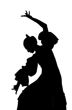Silhouette of Spanish woman Flamenco dancer dancing Sevillanas in gypsy dress