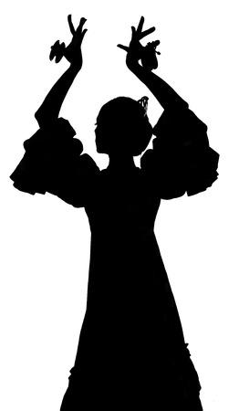 Silhouette of Spanish woman Flamenco dancer dancing Sevillanas in gypsy  dress  photo