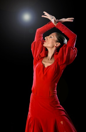 young Spanish woman dancing Sevillanas and Flamenco wearing gypsy red dress  photo