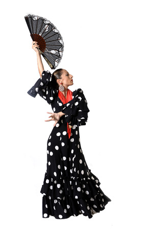 spanish woman dancer dancing Sevillanas wearing fan and traditional folk black with white dots dress photo